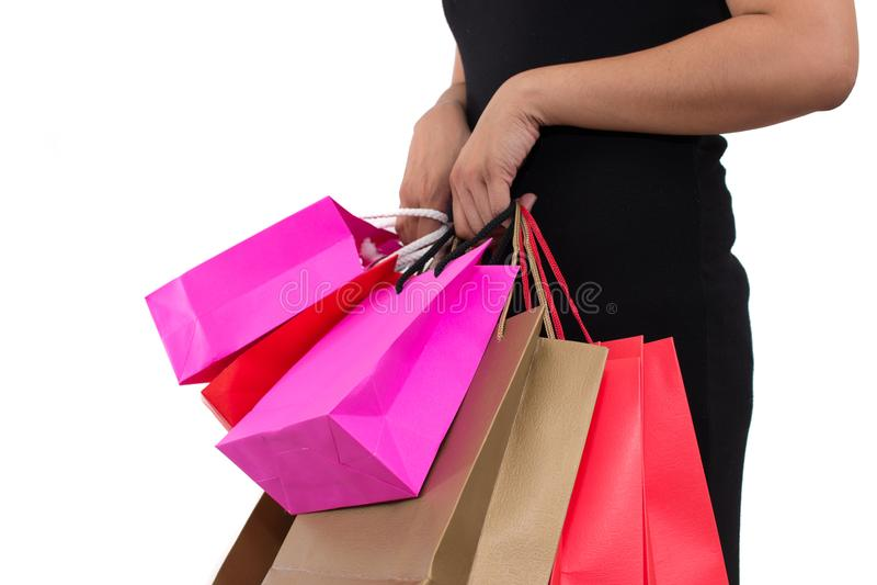 Midsection del primo piano di bella giovane donna asiatica con i sacchetti della spesa variopinti fotografie stock libere da diritti