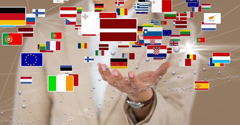 Midsection dell'uomo d'affari con le varie bandiere fotografia stock