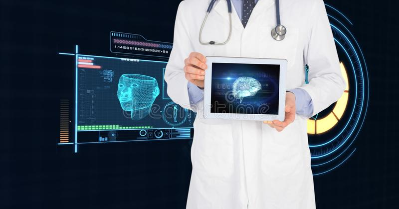 Midsection of doctor showing digital tablet with medical interface stock photos