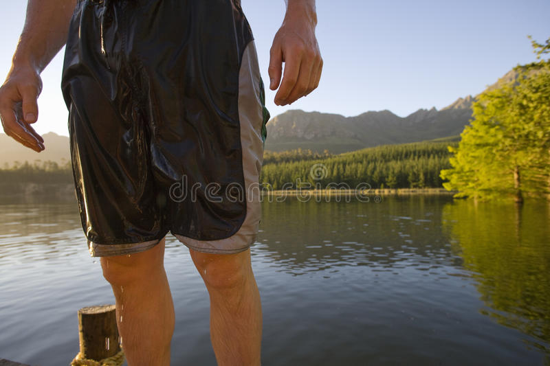 Midsection of man in wet swim trunks stock photography