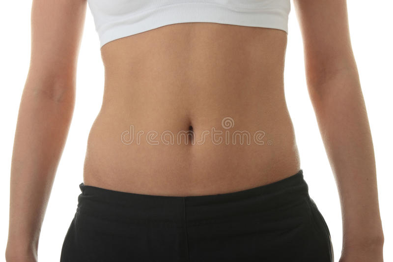 Midsection of a physically fit young woman royalty free stock images