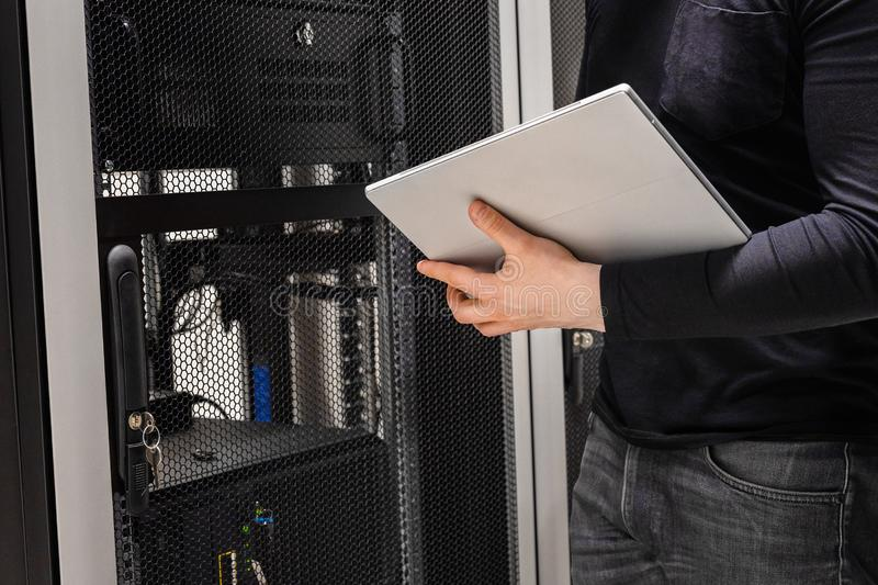 Midsection of IT Support Using Digital Tablet in Large Datacenter royalty free stock image