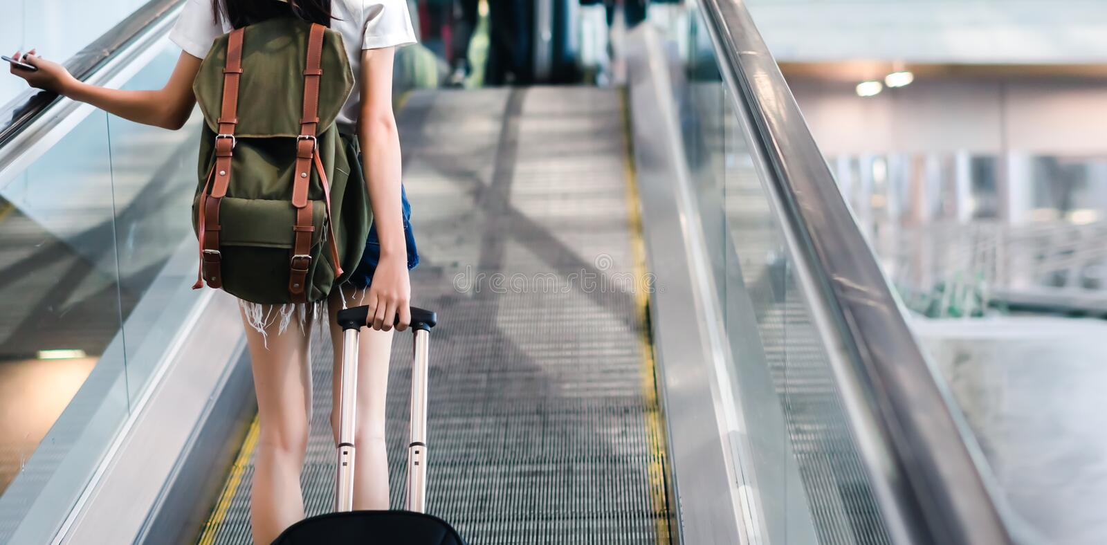 Midsection Woman With Luggage Traveling at Airport. Terminal Vacation Summer Relaxation holding Suitcase and Backpack stock photo