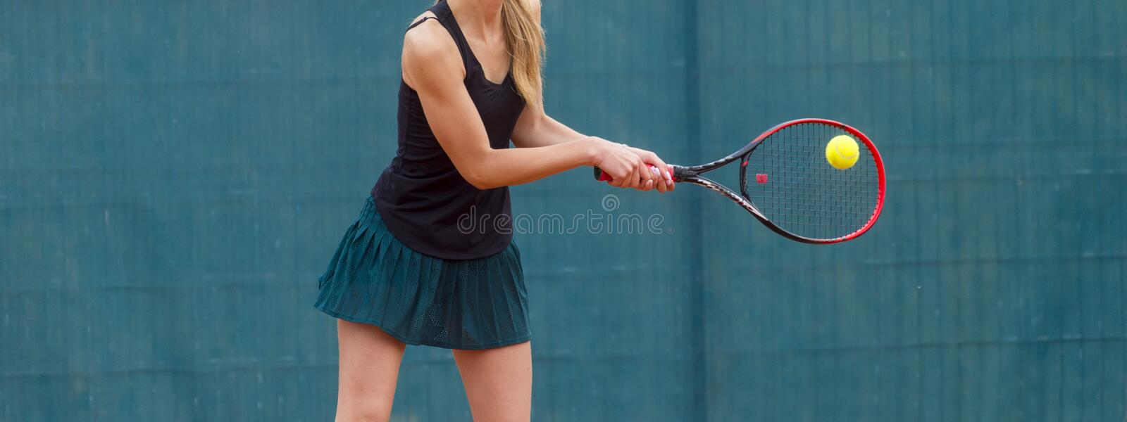 Midsection Of Woman Playing Tennis In Court royalty free stock photos