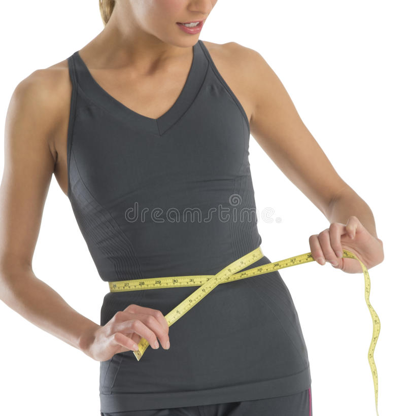Download Midsection Young Woman Measuring Her Waistline Stock Image - Image: 32278581