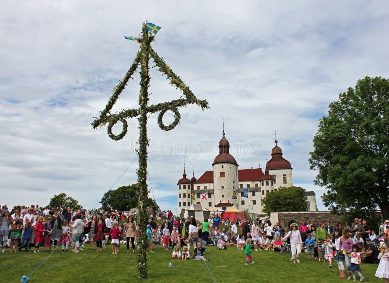 Midsummer celebrations in Sweden. Midsummer celebrations in front of Lacko castle at lake Vanern, Sweden royalty free stock images