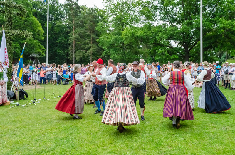 Midsummer dance. Record: June 21st 2013 Ramna Parken,Boras,Sweden. Dancers in traditional Swedish costumes performing in midsummer festival stock photos