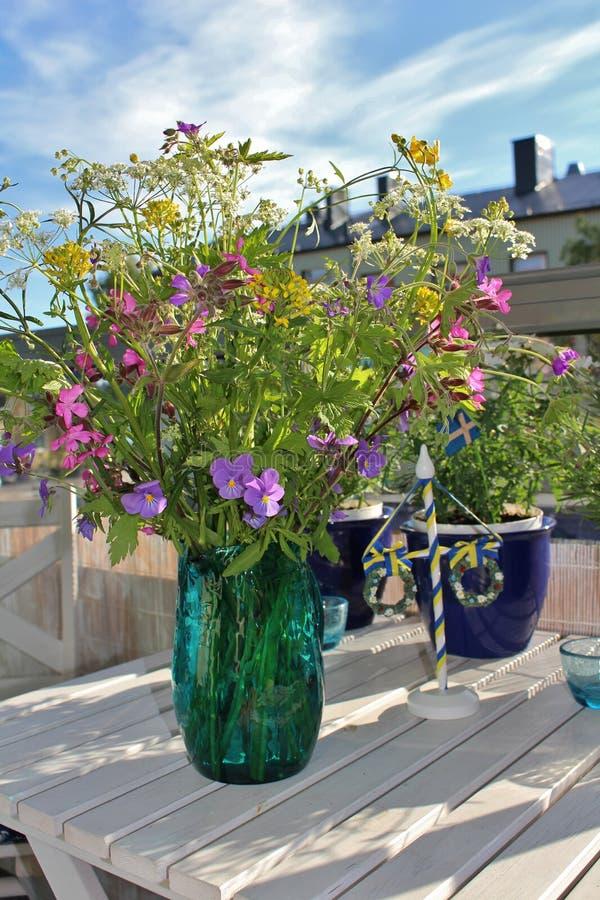 Midsummer Flowers. A bouquet of beautiful wild midsummer flowers on the balcony stock photos