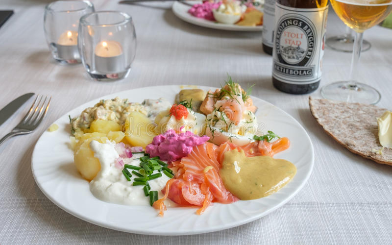 Midsummer food in Sweden. Norrkoping, Sweden - June 23, 2017: Traditional Swedish midsummer food with gravlax and herring. Midsummer ranks second only to stock photography