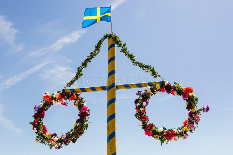 Midsummer. Flower wreath with Swedish flag royalty free stock photos