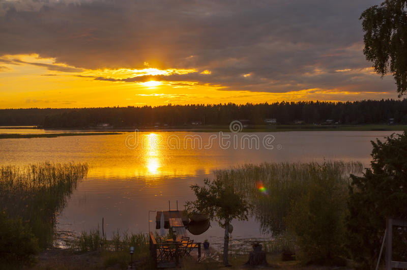 Midsummer sunset. At around 10 pm with a promise of a beautiful day. Lake Vanern, Karlstad, Sweden royalty free stock photo