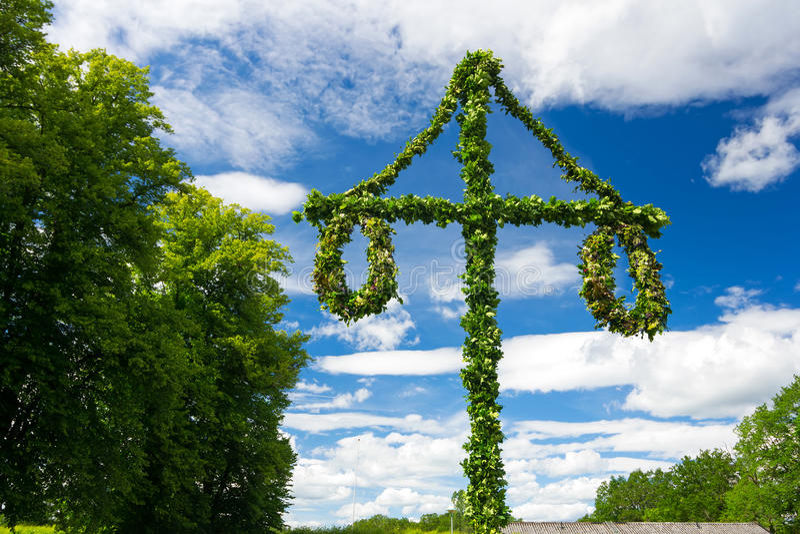 Midsummer Swedish pole. Swedish midsummer pole at blue sky royalty free stock photo