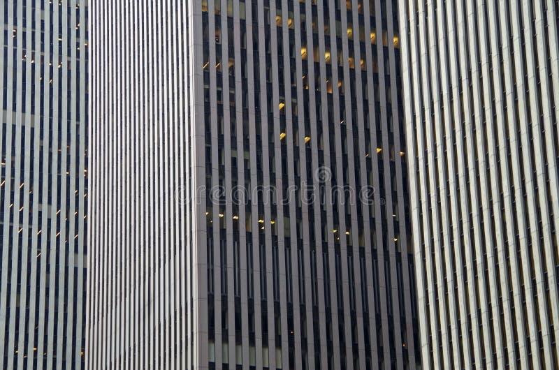 Midtown Manhattan architectural background. Midtown Manhattan NYC intersecting high-rise buildings architectural background royalty free stock photos