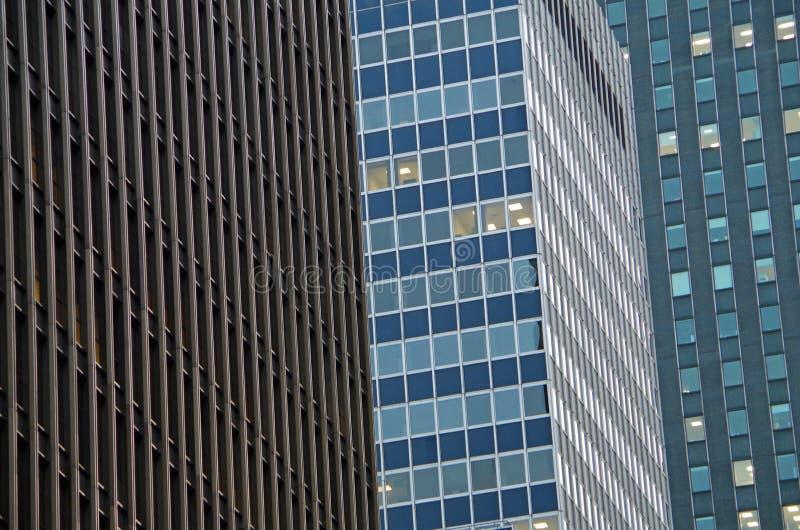 Midtown Manhattan architectural background. Midtown Manhattan NYC intersecting high-rise buildings architectural background royalty free stock images
