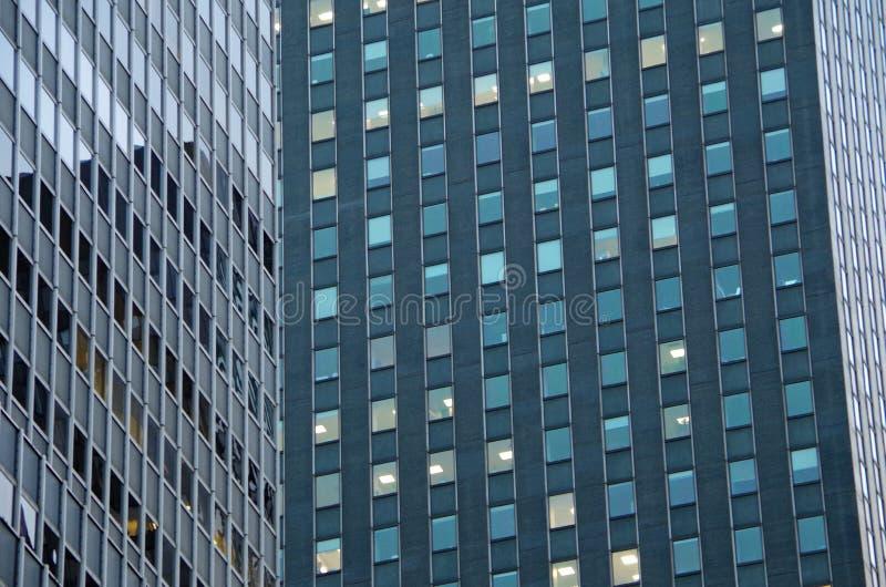Midtown Manhattan architectural background. Midtown Manhattan NYC intersecting high-rise buildings architectural background stock photo