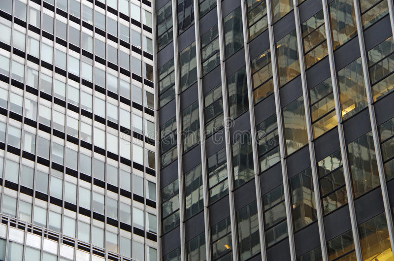 Midtown Manhattan architectural background. Midtown Manhattan NYC intersecting high-rise buildings architectural background stock photography