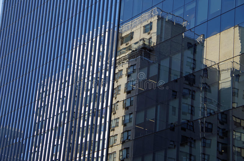 Midtown Manhattan architectural background. Midtown Manhattan NYC intersecting high-rise buildings architectural background reflections royalty free stock image