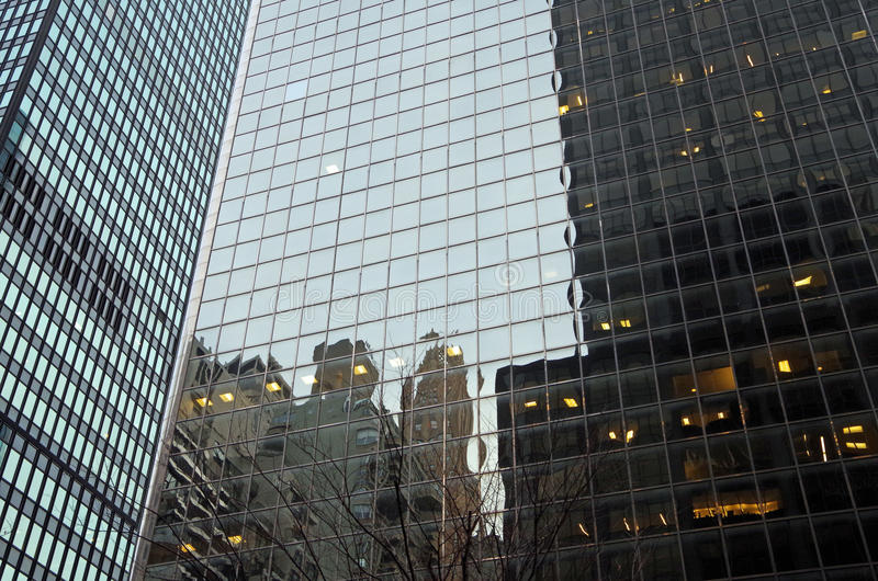 Midtown Manhattan architectural background. Midtown Manhattan NYC intersecting high-rise buildings architectural background reflections stock photo