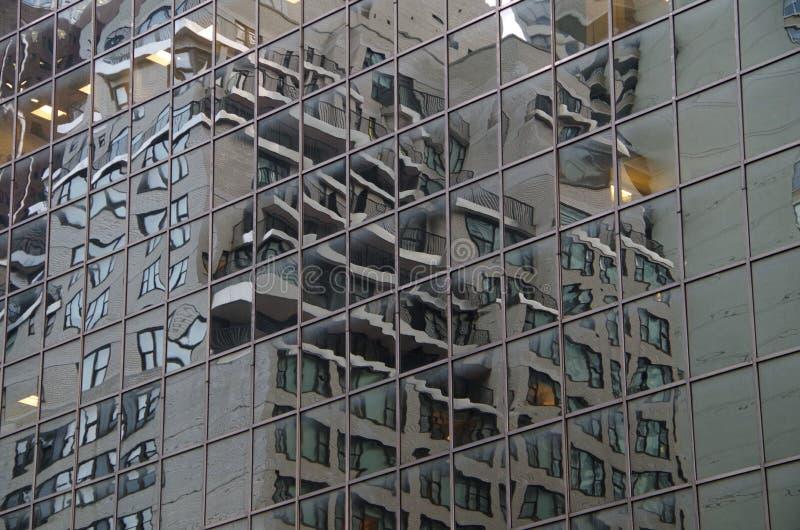 Midtown Manhattan architectural background. Midtown Manhattan NYC intersecting high-rise buildings architectural background reflections stock image