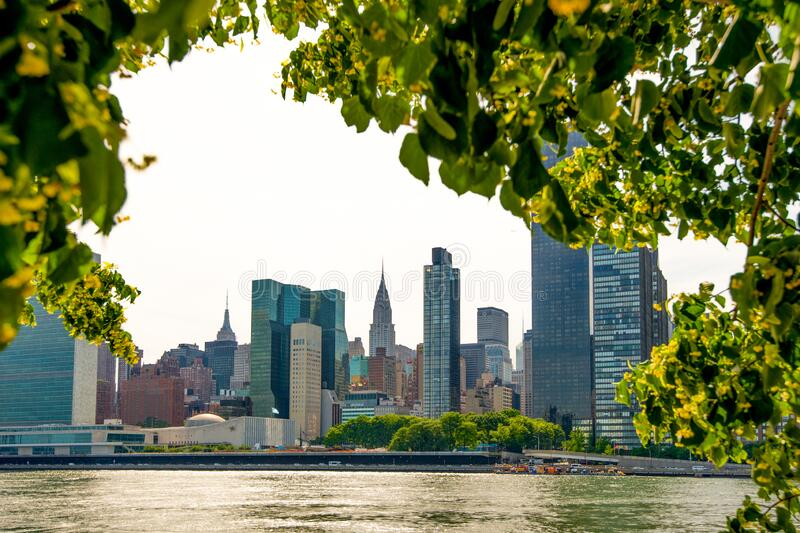 Midtown Manhattan with New York City skyline over East River royalty free stock image