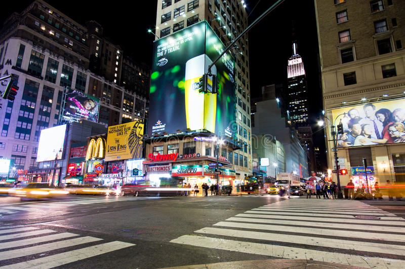 Midtown Manhattan Night. NEW YORK CITY - SEPT 13: Intersection in Midtown Manhattan seen on the night of Sept. 13, 2012. As NYC's largest business district stock photography