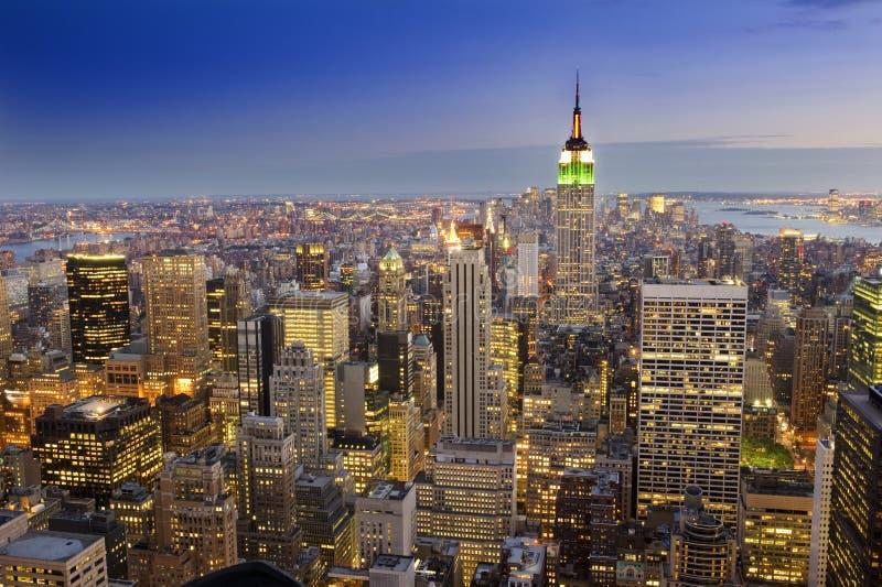 Midtown Manhattan skyline. A striking image of the midtown Manhattan skyline photographed after sunset royalty free stock image
