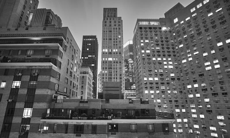 Midtown New York City buildings at night, USA. Black and white picture of midtown New York City buildings at night, USA stock photography
