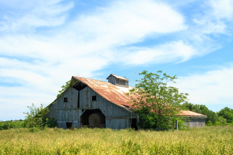 Midwest Hay Barn. A hay barn in a Midwest Field stock photos