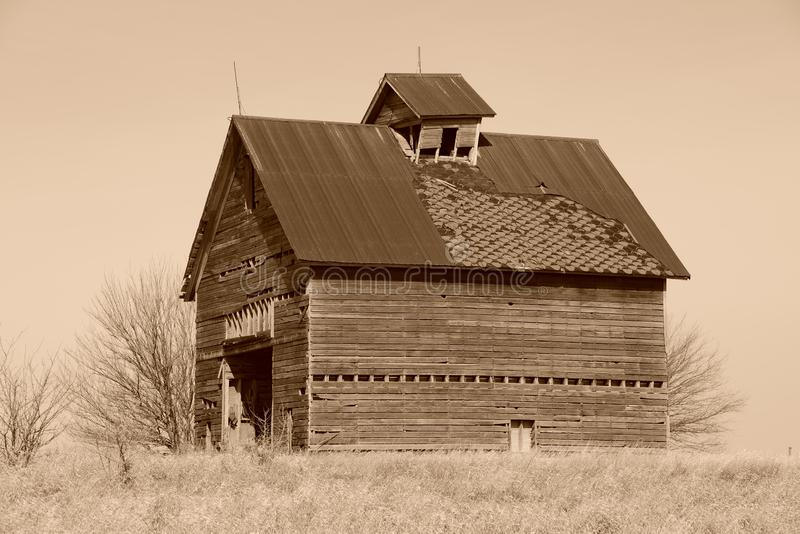Midwestern deteriorating old barn. Barn near Odell, Illinois in Livingston County.  Black and white image royalty free stock photo