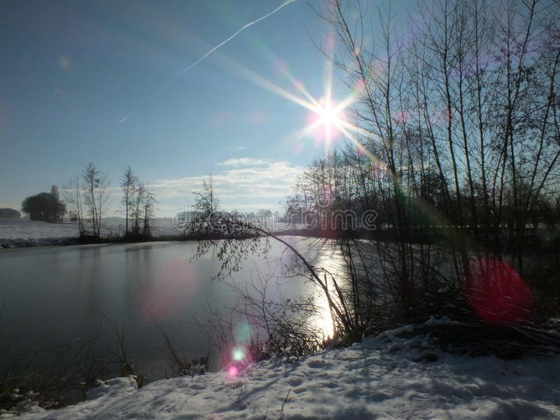 Midwinter Markelo. Frozen pond with low sun azimuth in Markelo Netherlands stock photo