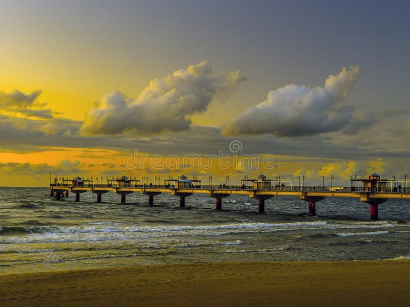 Miedzyzdroje Pier against after-the-sunset sky, Baltic Sea, Poland royalty free stock photos