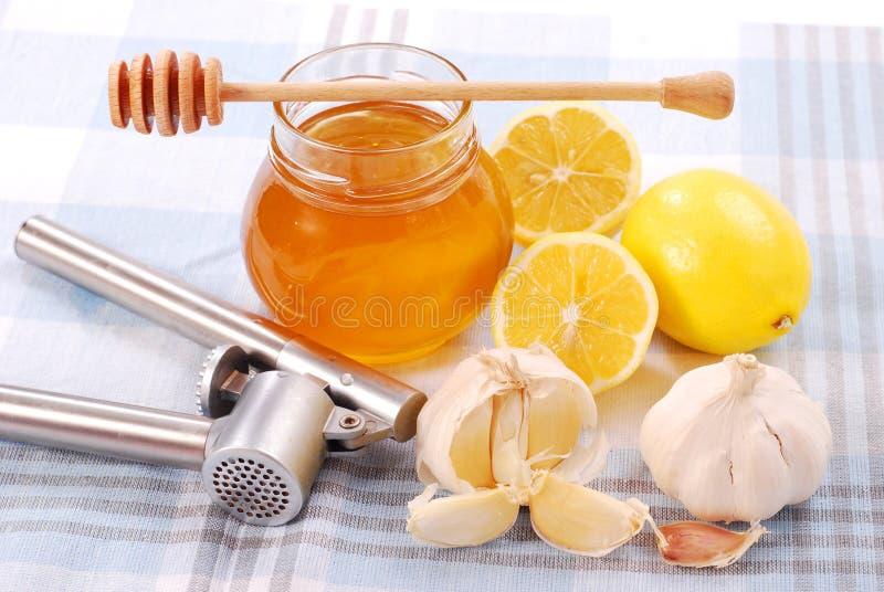 Miel, ail et citron photo stock