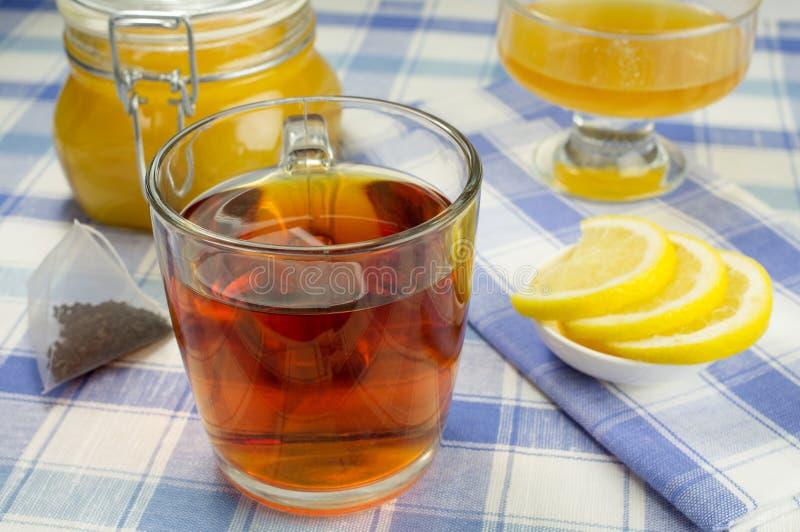 Miel, citron, thé photographie stock libre de droits
