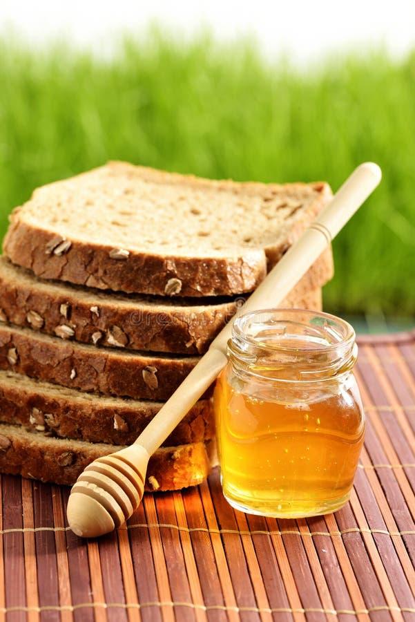 Miel con pan imagen de archivo