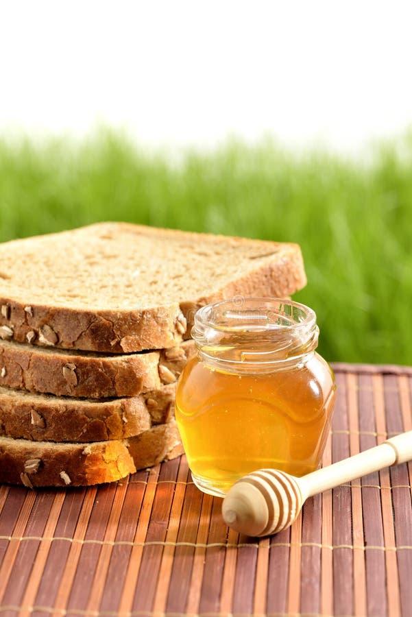 Miel con pan fotos de archivo