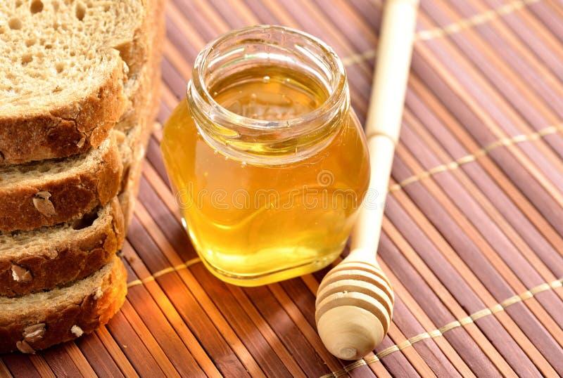 Miel con pan fotografía de archivo
