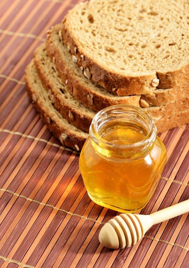 Miel con pan foto de archivo libre de regalías