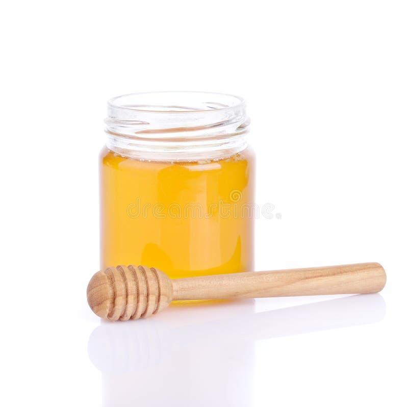 Miel dans le pot en verre photos stock