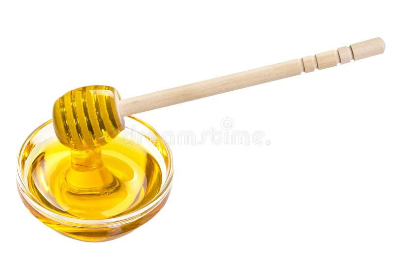 miel dans une tasse en verre cuillère pour le miel dans une tasse images stock