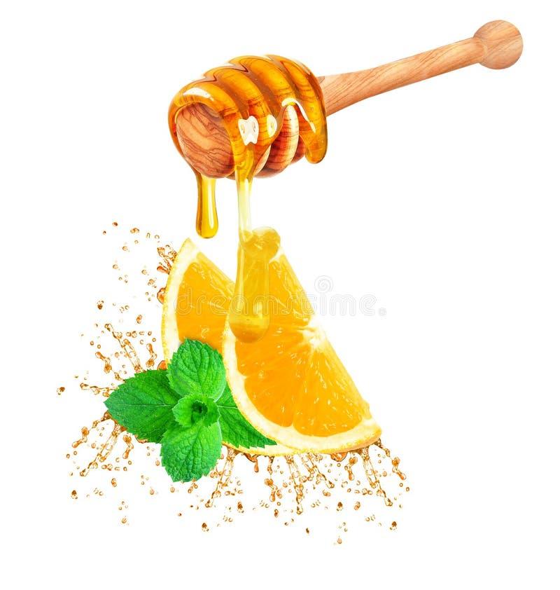 Miel et éclaboussure orange photos stock
