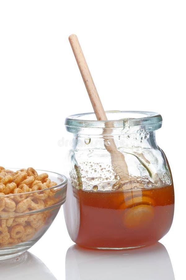 Miel et céréales photo stock