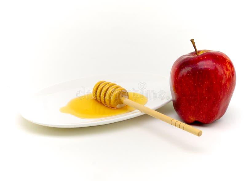 Miel et pomme pour Yom Kippour photographie stock libre de droits