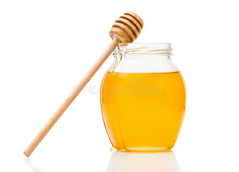 Miel naturel dans un pot en verre images libres de droits