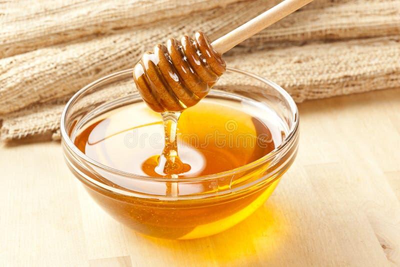 Miel organique d'or photo libre de droits