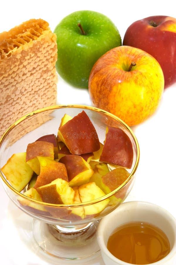 Miel y manzanas imagen de archivo libre de regalías