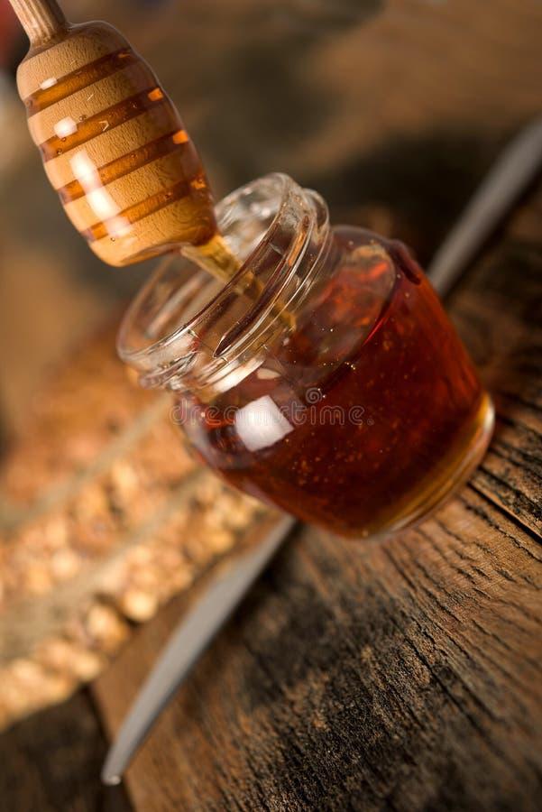 Miel y pan foto de archivo libre de regalías