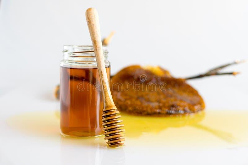 Miele con il favo fotografia stock