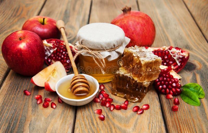 Miele con il melograno e le mele fotografia stock libera da diritti