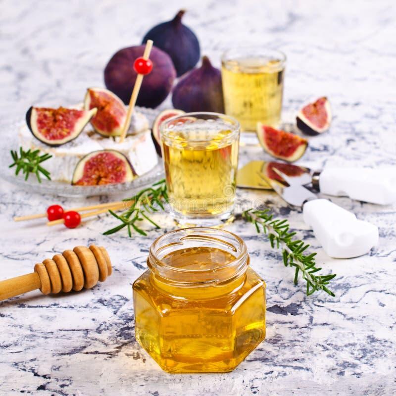 Miele dorato liquido immagine stock