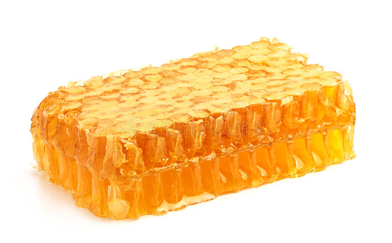 Miele in favo fresco. fotografia stock